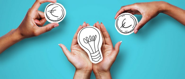 hands-holding-drawings-of-lightbulb-and-money